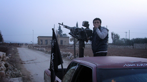 A man holds his rifle during clashes between the Free Syrian Army and ISIS in Aleppo, Syria, on Jan. 4. The fighting between the rebels and ISIS militants is taking place in Aleppo and Raqqa.