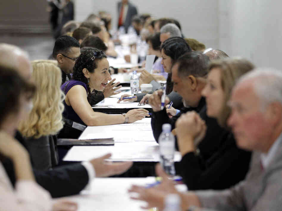 Job seekers have their resumes reviewed at a job fair expo in Anaheim, Calif., in June 2012.