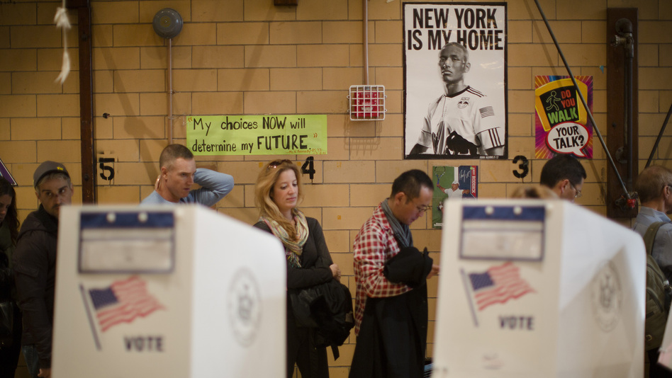 Voters wait to cast ballots at a school in New York City on Nov. 6.