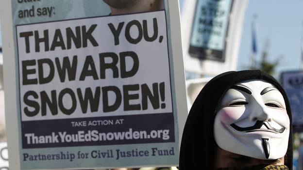 A demonstrators shown during a march in October outside Capitol Hill demanding that Congress investigate the NSA. (AP)