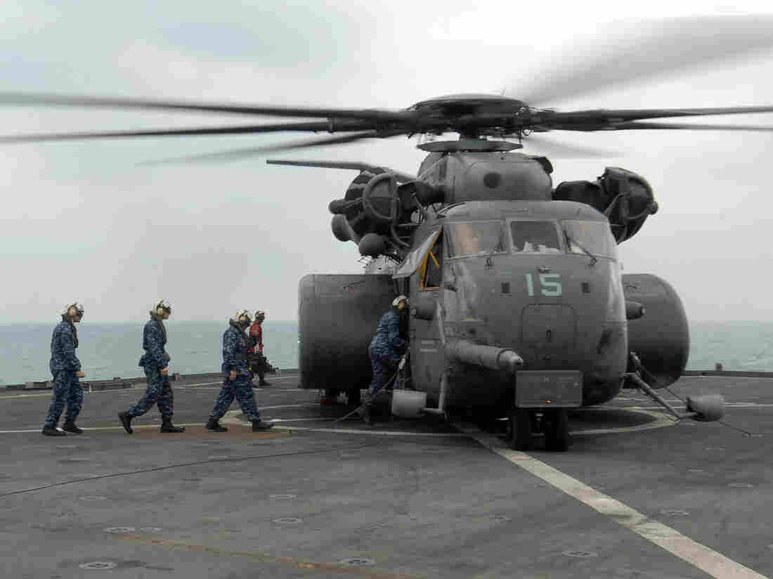 U.S. Navy crew members board a MH-53E helicopter in 2011. The Sea Dragon helicopter is similar to the one that crashed off Virginia on Wednesday.