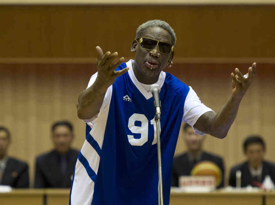"Dennis Rodman sings ""Happy Birthday"" to North Korean leader Kim Jong Un, seated above in the stands, before an exhibition basketball game Wednesday at an indoor stadium"