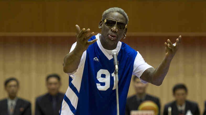"Dennis Rodman sings ""Happy Birthday"" to North Korean leader Kim Jong Un, seated above in the stands, before an exhibition basketball game Wednesday at an indoor stadium in Pyongyang, North Korea."