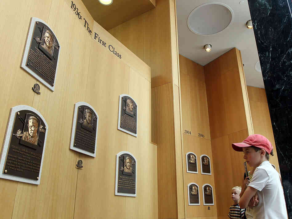At the Baseball Hall of Fame in Cooperstown, N.Y., a young fan reads about the game's greats.
