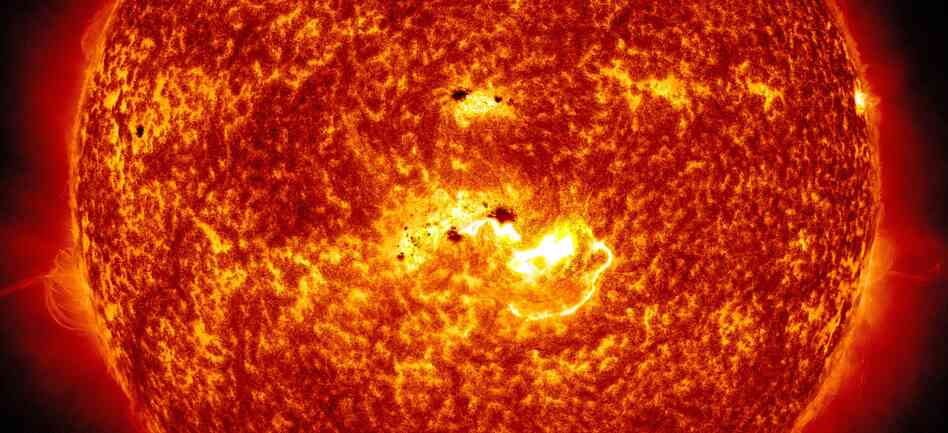 Coming At You: An image created by NASA combines two pictures from its Solar Dynamics Observatory. One shows the location of a large sunspot; the other shows Tuesday's massive solar flare.