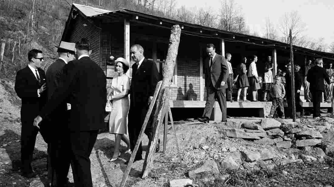President Lyndon Johnson and his wife, Lady Bird, leave a home in Inez, Ky., during a 1964 visit to Martin County.