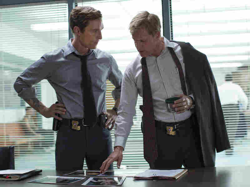 Matthew McConaughey (left) and Woody Harrelson play partner detectives Rustin Cohle and Martin Hart in HBO's True Detective.