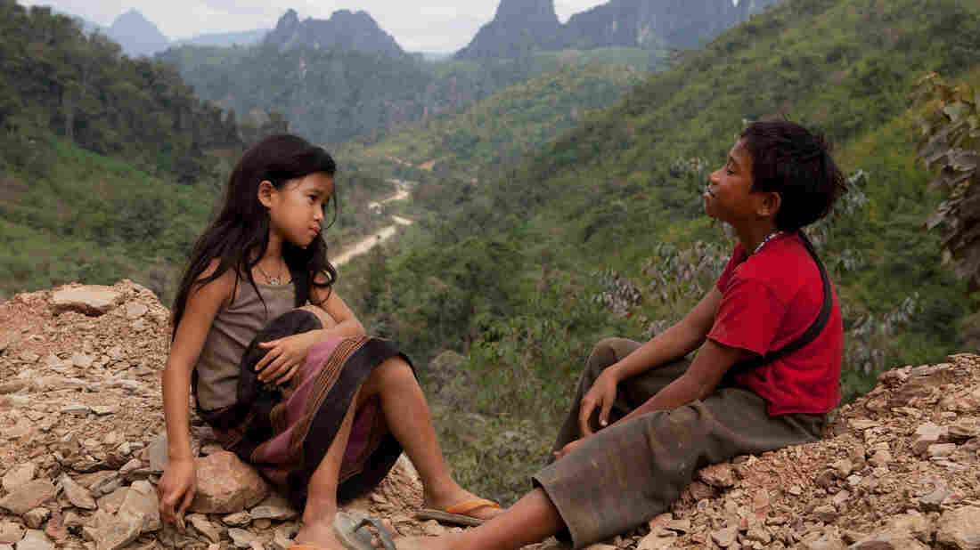 Kia (Loungnam Kaosainam) and Ahlo (Sitthiphon Disamoe) bond when they encounter each other in a Laotian refugee village in The Rocket.