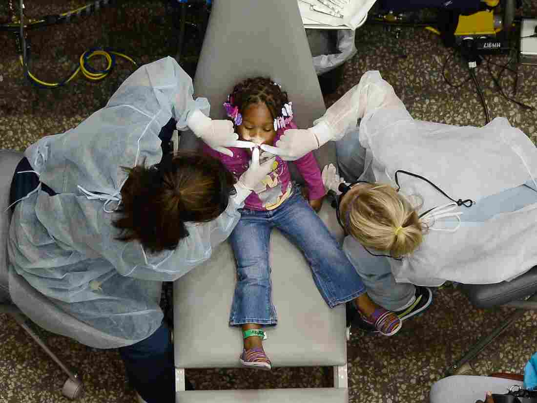 Kamora Cyprian got her teeth cleaned at a free health care event in the Los Angeles Sports Arena in September 2012.