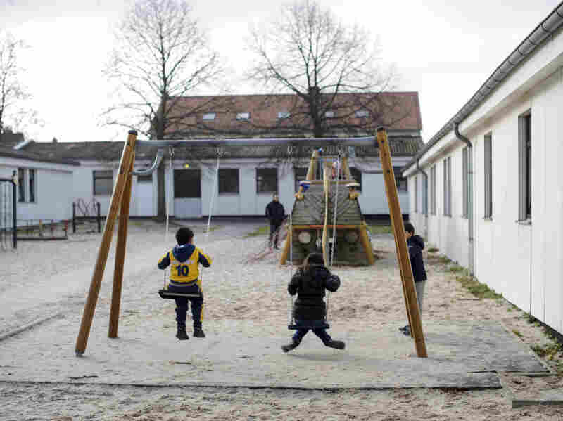 Syrian refugees play on the swings in the playground at the Friedland refugee center on Dec. 10.