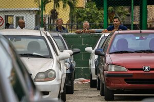 Cubans look at new and used foreign-made cars for sale at a car dealer in Havana on Jan. 3.