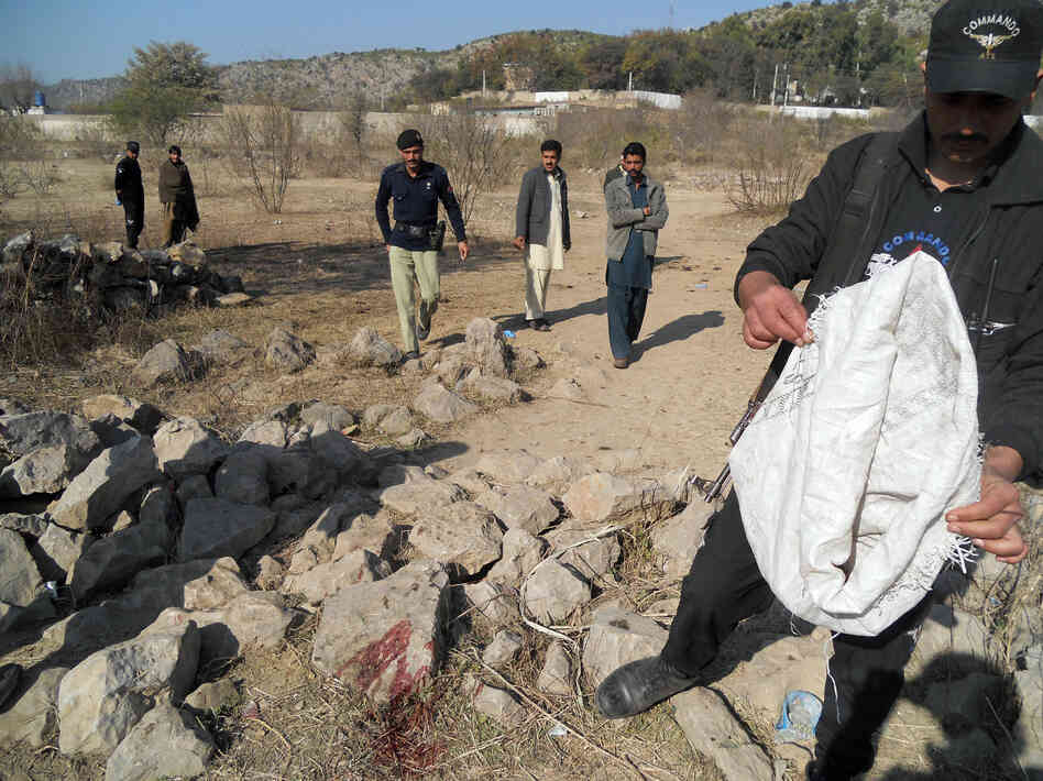 Pakistani security personnel examine the site of a suicide bombing in the Ibrahimzai area of Hangu, Pakistan, on Monday. The bombing killed 15-year-old Aitizaz Hasan, who prevented the bom