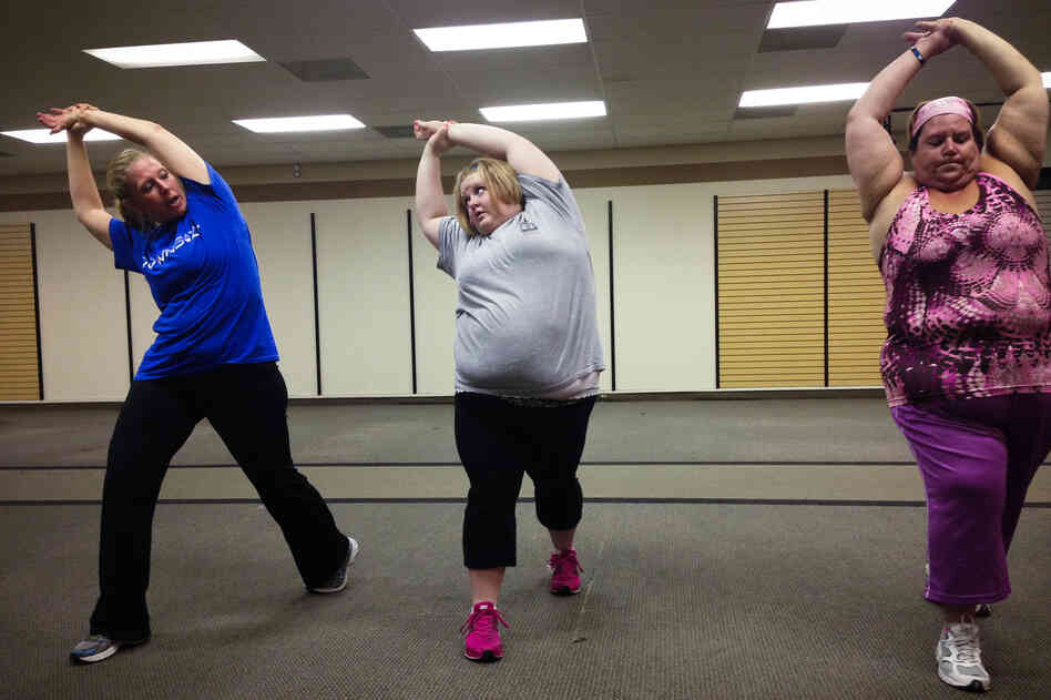 Kendall Schrantz, center, stretches after a class at Downsize Fitness in Fort Worth.