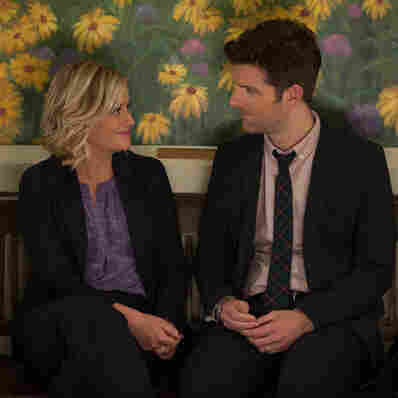 Amy Poehler as Leslie Knope and Adam Scott as Ben Wyatt on NBC's deeply pro-nerd Parks And Recreation.