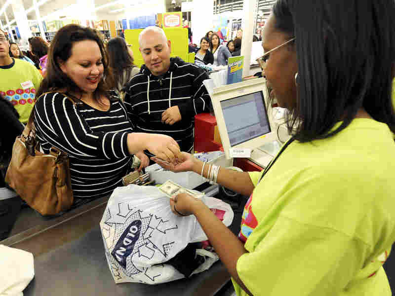 Shoppers make a purchase at an outlet mall in Los Angeles. Employers added 55,000 jobs in the retail sector in December.