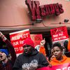 Protesters rally outside of a Wendy's in Brooklyn, New York, on Dec. 5 in support of raising fast food wages from $7.25 to $15 per hour.
