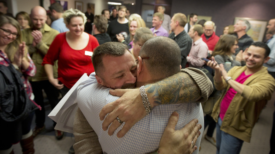 Chris Serrano, left, and Clifton Webb embrace after being married on Dec. 20 in the Salt Lake County Clerk's Office in Salt Lake City.