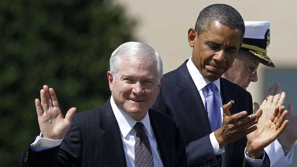 Robert Gates waves and President Obama claps at the then-defense secretary's farewell ceremony in June 2011. (Reuters /Landov)