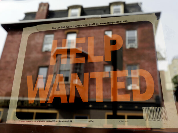 """Sign of the times? A """"help wanted"""" sign in the window of a Philadelphia business last year."""