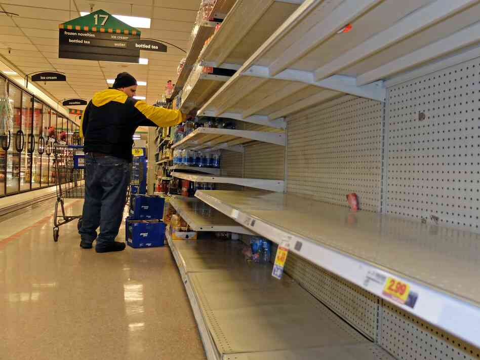 In Charleston, W.Va., the shelves of this Kroger supermarket had been nearly stripped of bottled water on Thursday. Residents rushed to buy water after a chemical spill led officials to warn that they not use what's coming out of their taps.