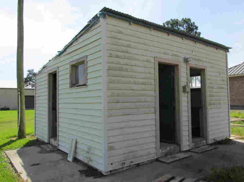 The old bathroom building behind Our Lady of Peace Catholic Church in rural Vacherie, La. The structure was demolished in October.