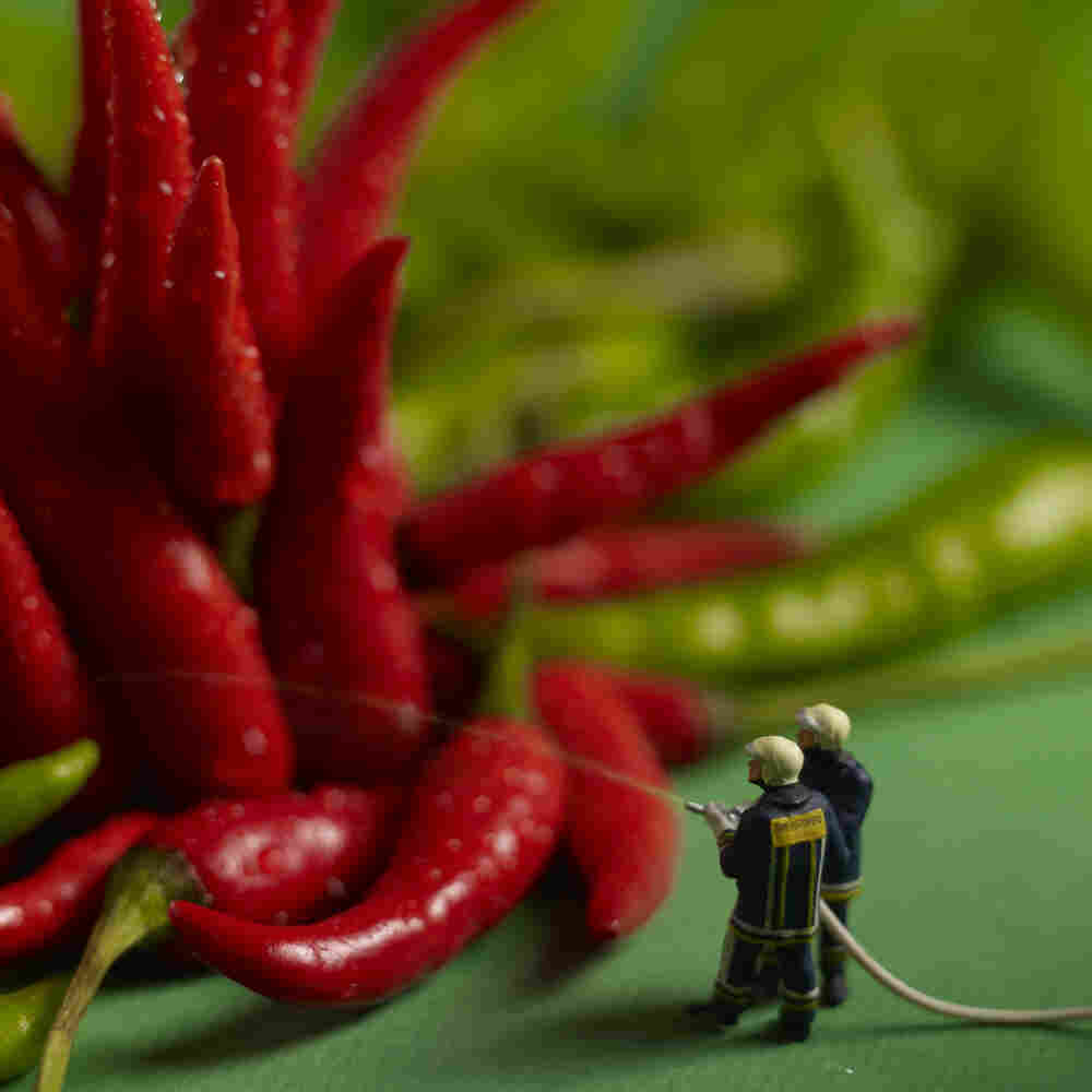 Firefighters fighting fiery hot peppers.