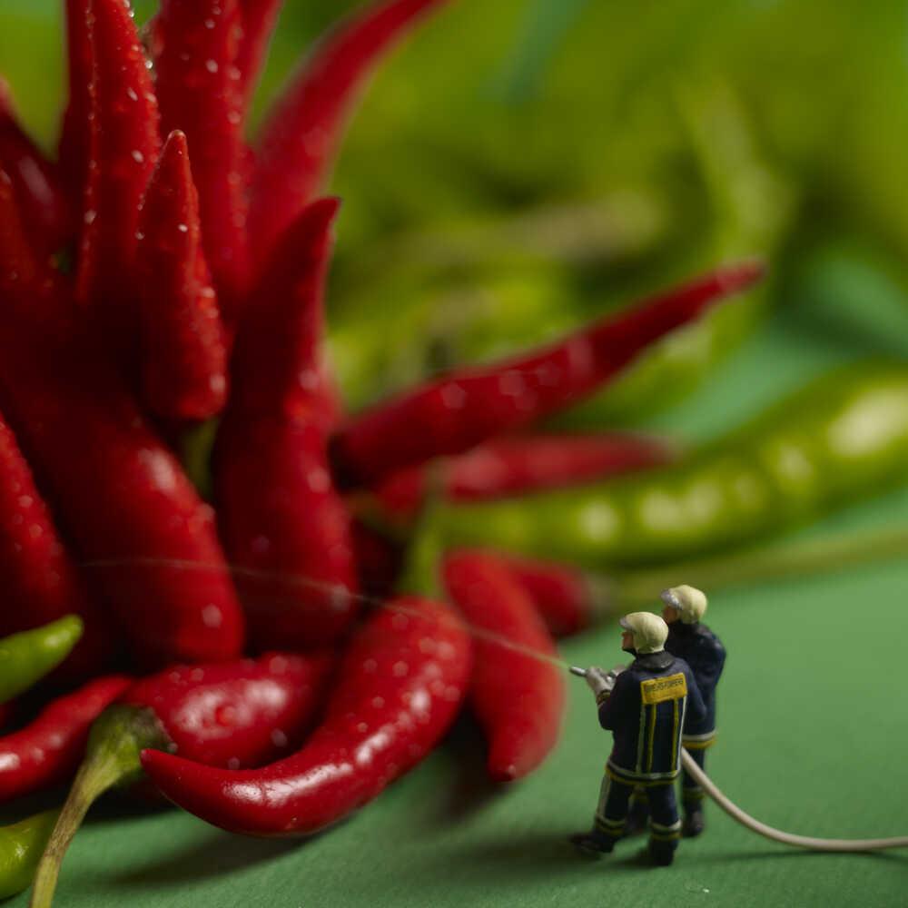 Firefighters fighting fiery hot peppers.