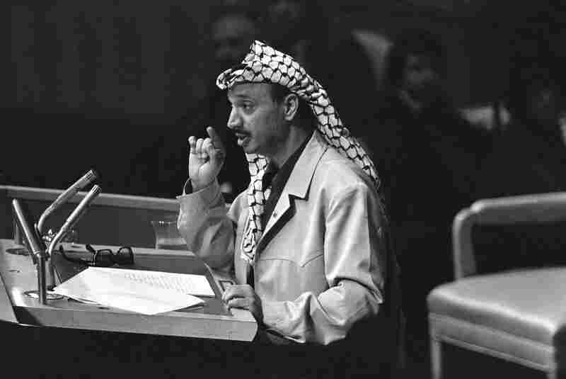 "Yasser Arafat speaks at the United Nations in 1974. At the end of his speech, Arafat shook his finger at the delegates and declared, ""I have come bearing an olive branch and a freedom fighter's gun. Do not let the olive branch fall from my hand."""