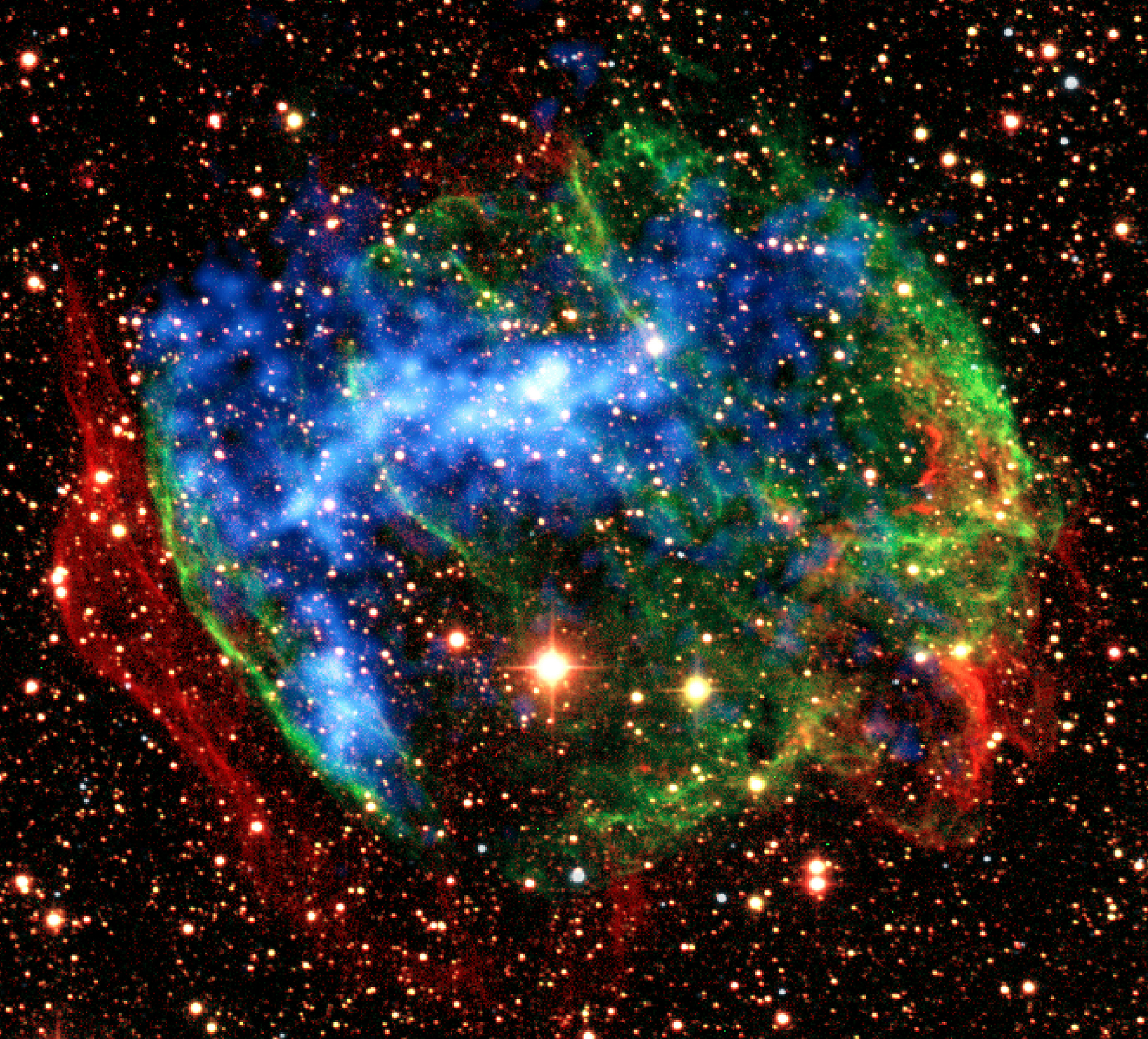 This image provided by NASA Wednesday Dec. 30, 2009 shows a view combining infrared images from the ground (red, green) with X-ray data from NASA's Chandra X-Ray Observatory in the supernova remnant W49B. Studies of two supernova remnants using the Japan-U.S. Suzaku observatory have revealed never-before-seen embers of the high-temperature fireballs that immediately followed the explosions. Eve...
