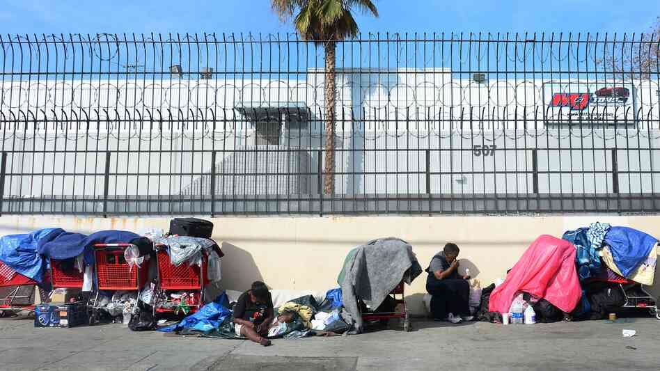 Homeless women sit amid their belongings in downtown Los Angeles on Wednesday. Democrats and Republicans say income inequality is a problem,