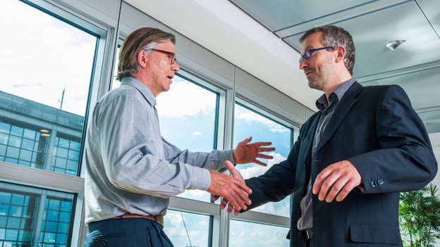 Research psychologist Peggy Drexler says one way to resist an unwanted hug at work is with a stiff handshake. (iStockphoto.com)