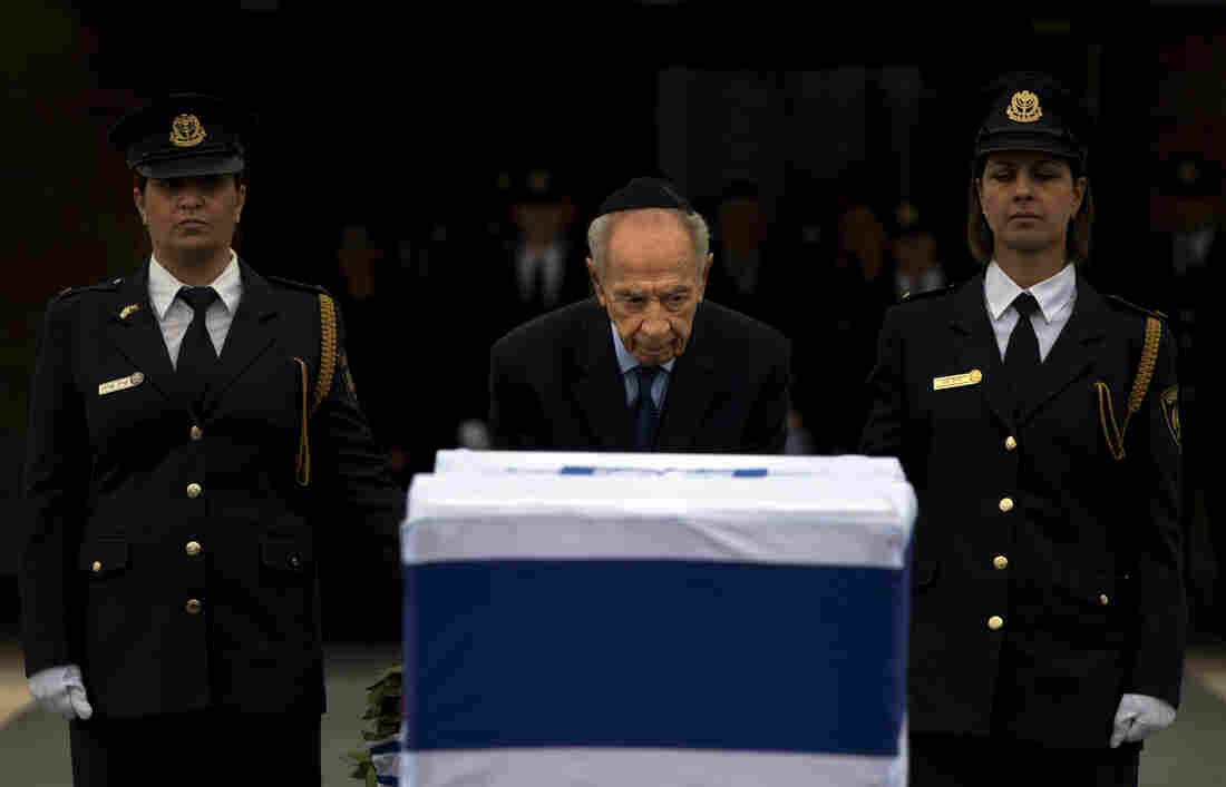 Israel's President Shimon Peres stands next the coffin of former Israeli Prime Minister Ariel Sharon at the Knesset in Jerusalem on Sunday.