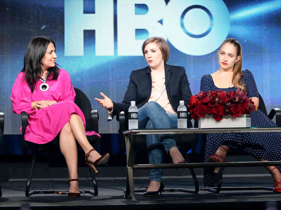 Girls executive producer Jenni Konner (from left), creator and star Lena Dunham and actress Jemima Kirke take questions on the first day of the Television Critics Association winter press tour.
