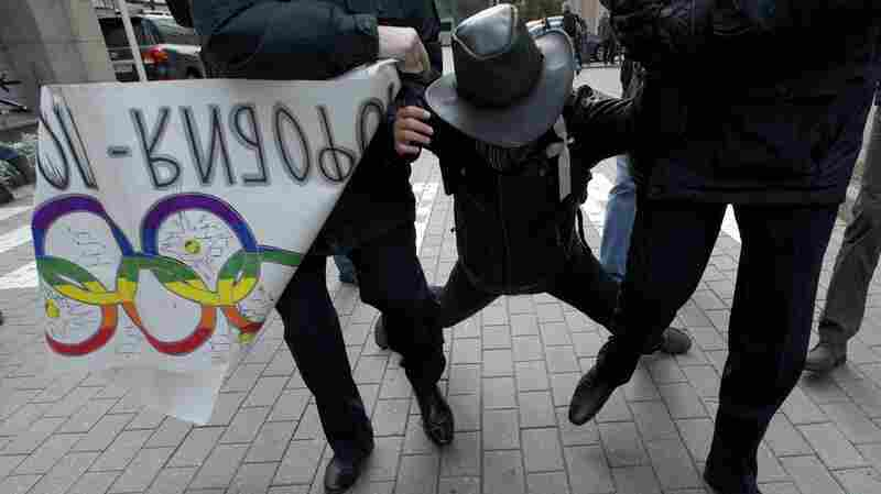 Russian police officers detain a gay-rights activist during a protest outside the Winter Olympics organizing committee office in Moscow. Clashes over gay rights put NBC in a difficult position: Olympic officials insist that the games should not be politicized, while activists push the network to report on the issue as a journalistic enterprise.