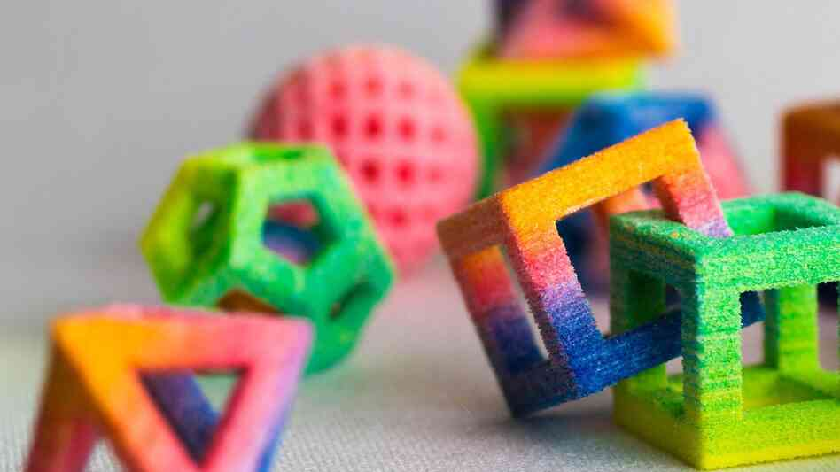 A mathematician's sweet dream: For about $10,000, you can print out rainbow sugar dodecahedrons and interlocking cubes.