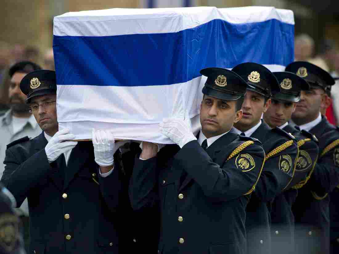 Israeli soldiers carry the coffin of former Prime Minister Ariel Sharon on Monday in Jerusalem.