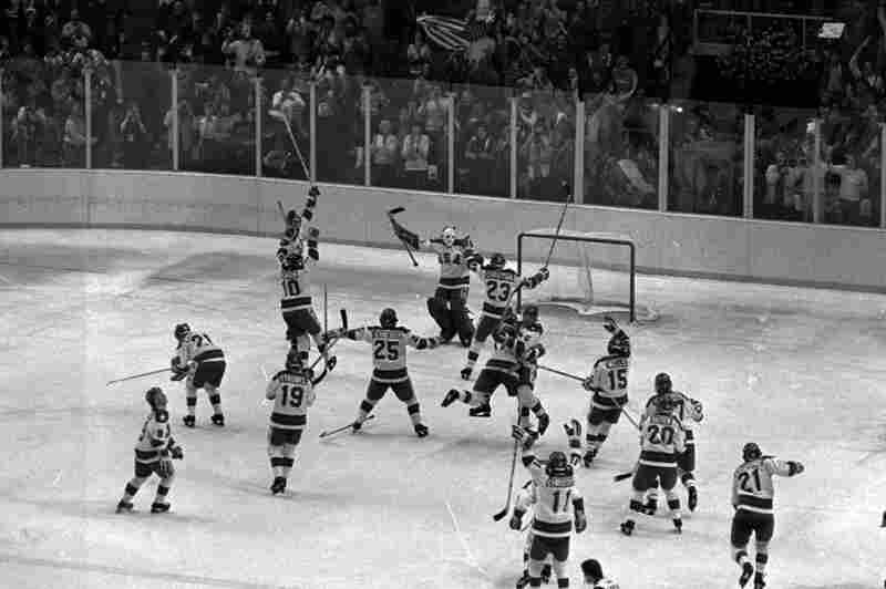 U.S. hockey team members leap on the ice after they upset the favored Soviet team by a 4-3 score at the 1980 Winter Olympics in Lake Placid, N.Y.