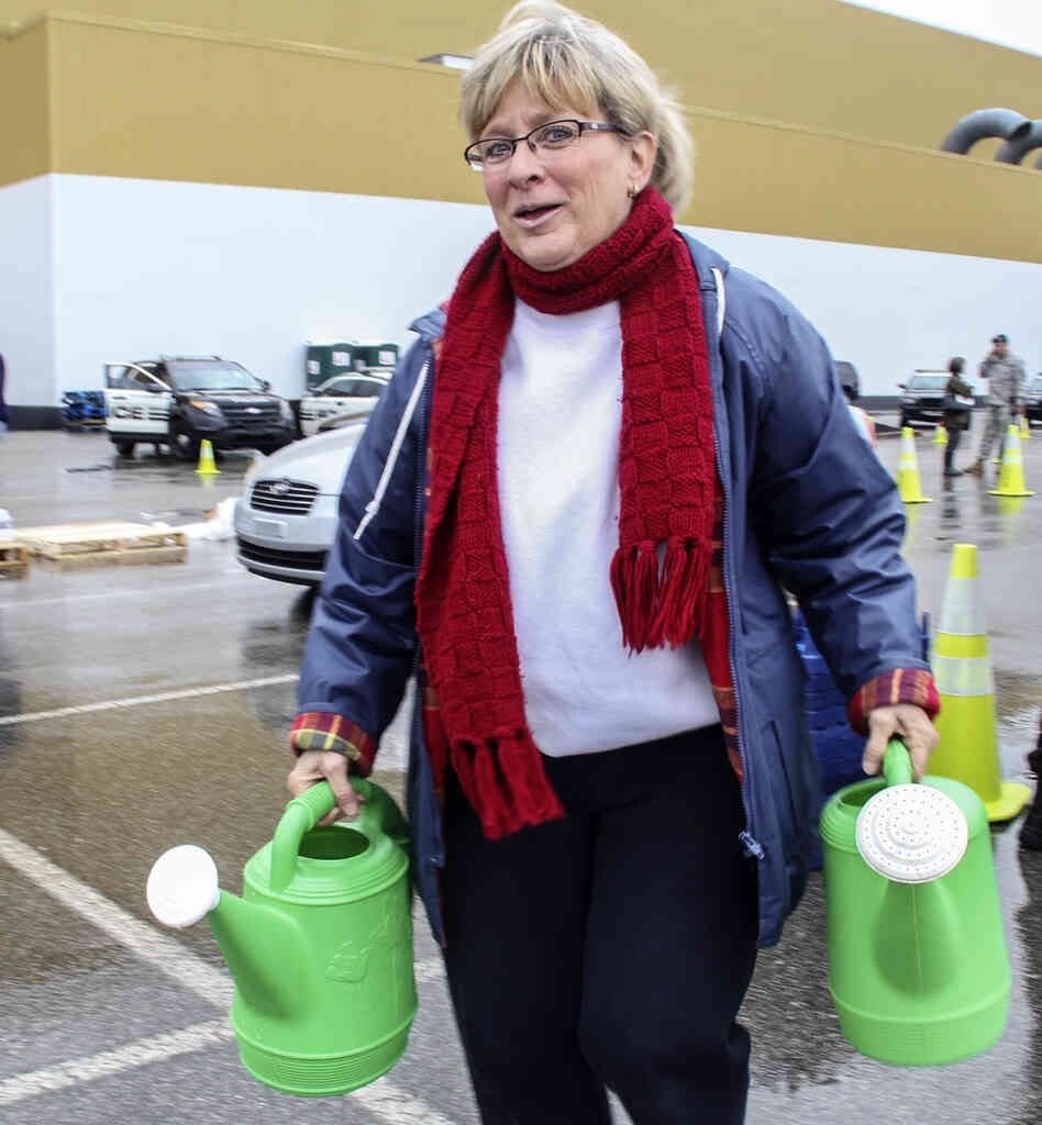 On Saturday in South Charleston, W.Va., Cathy Mabe was one of many who came to get water from a temporary filling station.