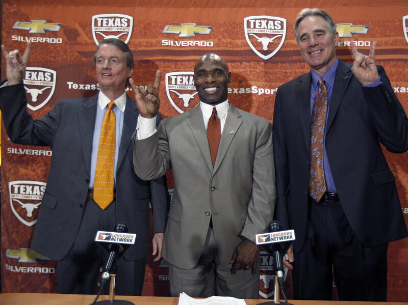 why the race of the new football coach at university of texas