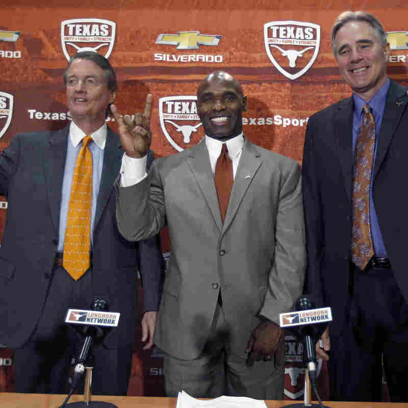 University of Texas president Bill Powers (left) and athletic director Steve Patterson (right) introduce new Longhorns head football coach Charlie Strong during a press conference January 6, 2014 at Darrell K. Royal-Texas Memorial Stadium in Austin, Texas.