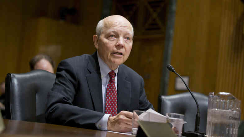 John Koskinen, President Obama's choice to head the Internal Revenue Service, testifies Dec. 10 on Capitol Hill before the Senate Finance Committee hearing on his nomination.