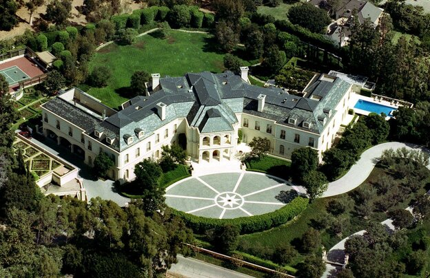 In this photo from 1993, television producer Aaron Spelling's Los Angeles home is shown. Spelling's widow placed the 56,000 square-foot house on the market for $150 million.