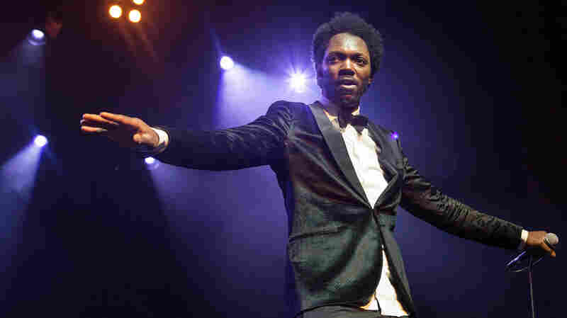 Congolese-Belgian artist Baloji started his globalFEST set at New York City's Webster Hall on Jan. 12, 2014 in high fashion — but by the end, he was working hard in rolled-up shirtsleeves.