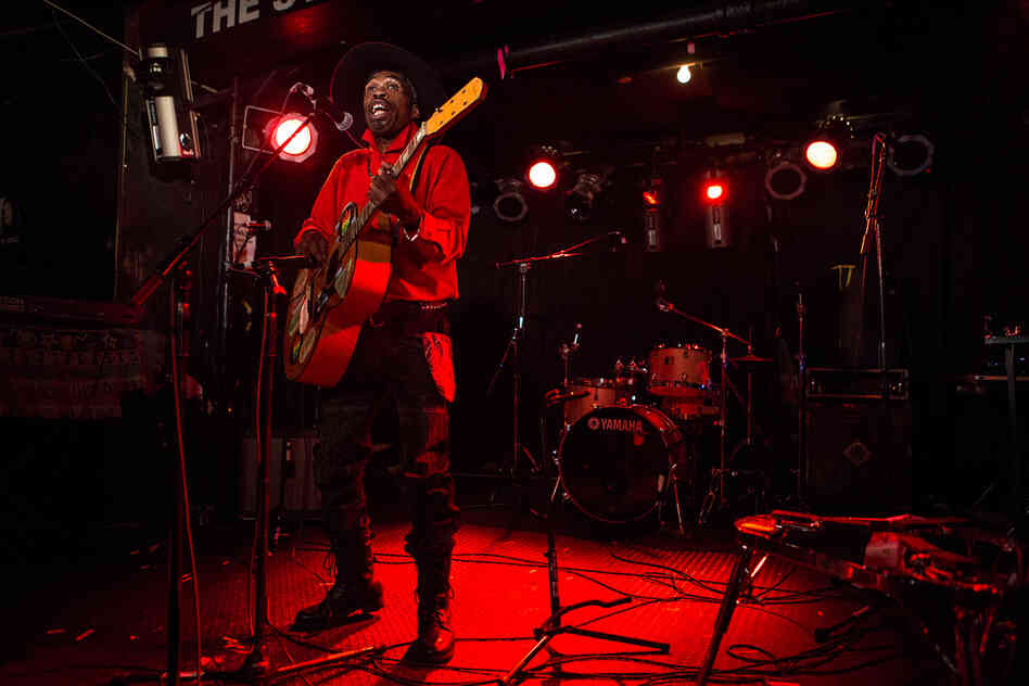 Playing a single-stringed guitar, the Jamaican artist Brushy One String held court in the intimate Studio space at New York City's Webster Hall during globalFEST on Jan. 12, 2014.