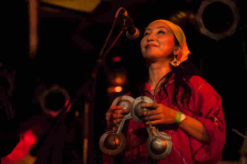 Percussionist and vocalist Chikako Iwahori plays the small brass castanet-like