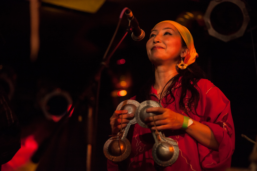 Percussionist and vocalist Chikako Iwahori plays the small brass castanet-like instruments called the qarqabat during Hassan Hakmoun's set.