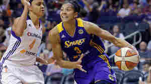 Candace Parker (right) of the Los Angeles Sparks and Candice Dupree of the Phoenix Mercury during Game 2 of their WNBA semifinal series in September.