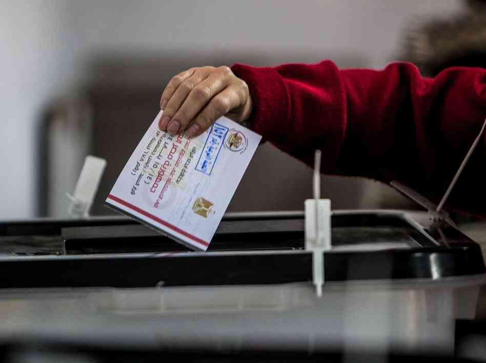 A woman casts her ballot Tuesday at a polling station in Nasr City, Cairo.