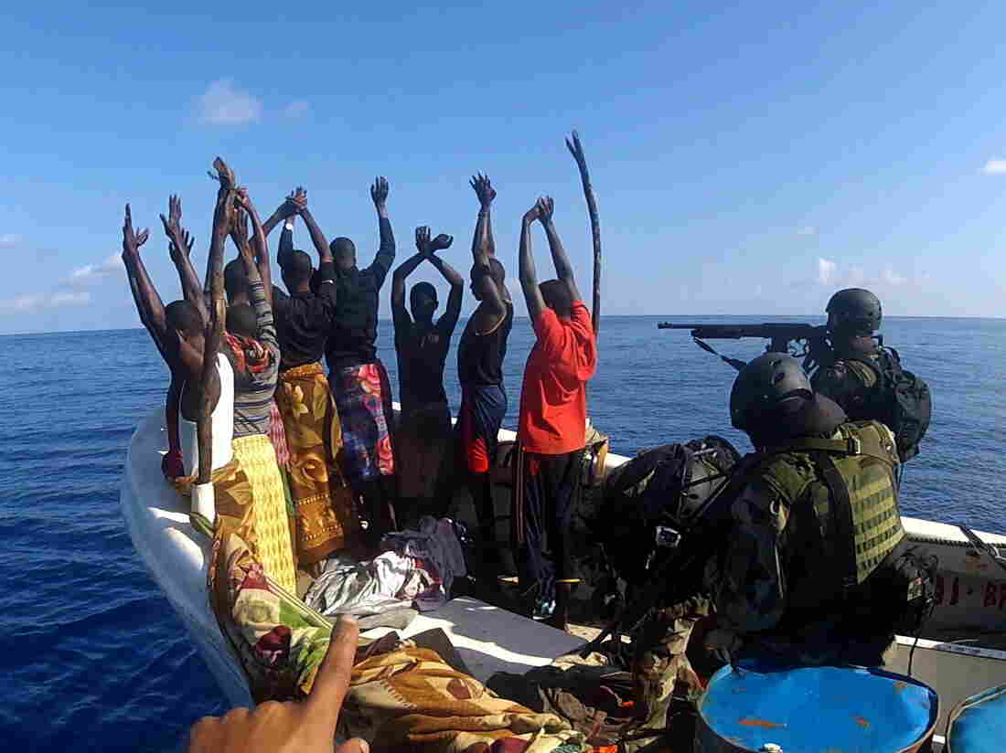 Troops from the EU Naval Force warship FS Aconit intercepting a group of suspected pirates off Somalia in March 2012. Multinational naval patrols in the area have been partly credited with reducing incidents of piracy.