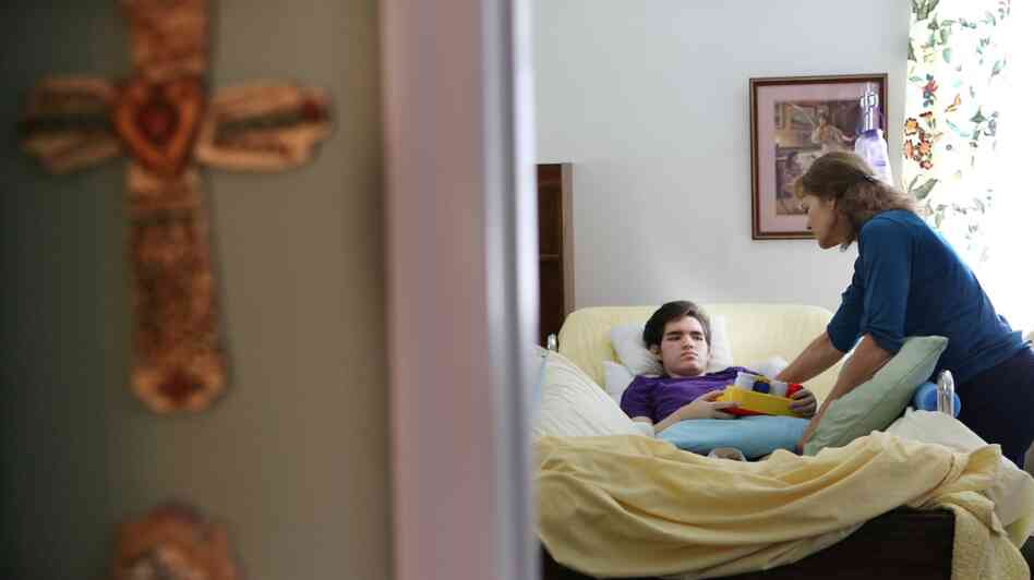 Marilyn Budzynski takes care of her 20-year-old son, Michael, in Eustis, Fla., in September. Michael suffers from Dravet syndrome, a severe form of epilepsy.